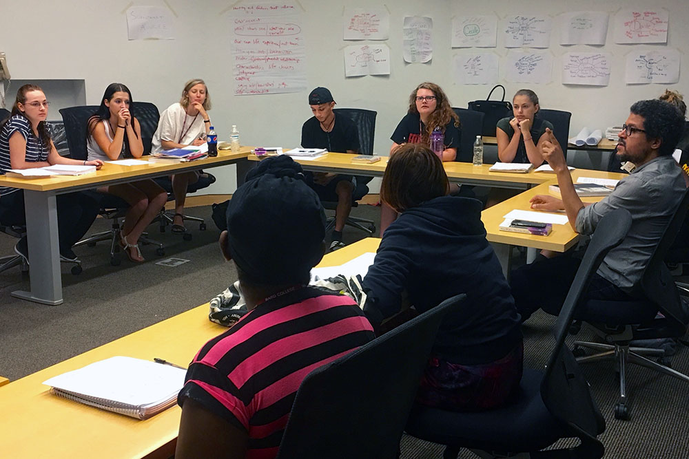 Bard MAT alum Xhosa Frazier '10 teaching a group of high school visitors from area districts.