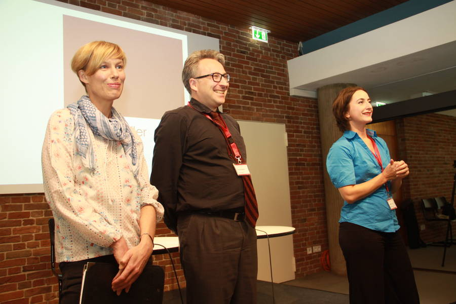 Anja Quickert, Florian Becker, and Janine Ludwig welcome the audience to thesecond day of the conference (October 4, 2014).