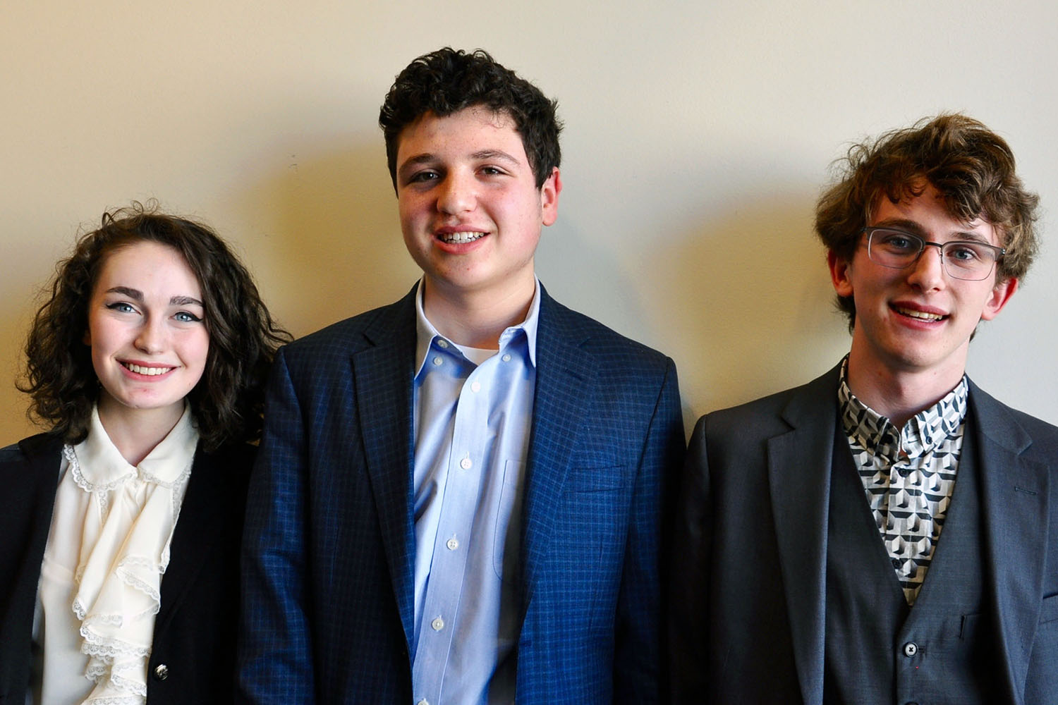 Red Hook High School students Emily Shein, Doug Appenzeller, and Joe Becker after their debate on climate change policy.