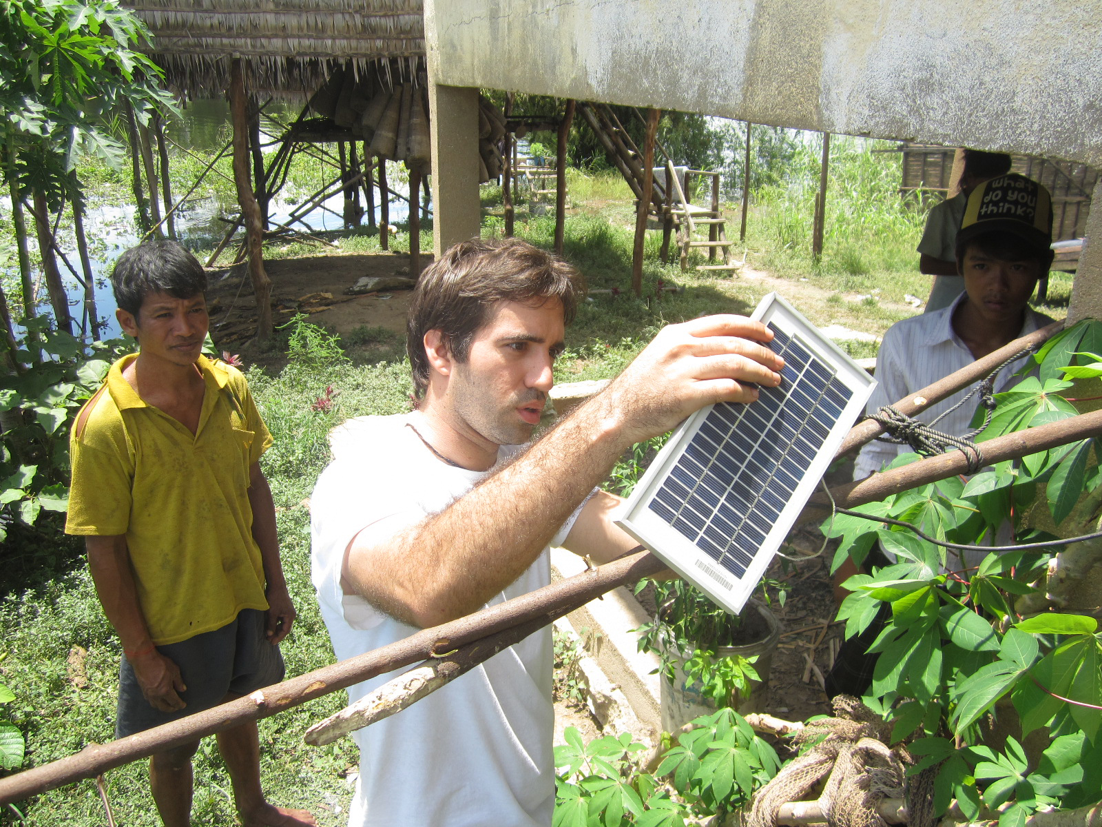 Daniel Pacheco '07 installs a temporary solar frame for a family whose housesank in heavy rain.