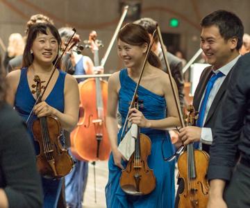 [Bartók's The Miraculous Mandarin] The Orchestra Now violinists Grace Choi, Adina Mu-Ying Tsai, and Shushi Hori, photo by Matt Dine